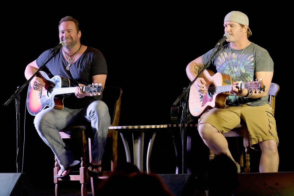Singers Lee Brice (L) and Jerrod Niemann perform onstage during CMT Story Behind The Songs LIV+ weekend at Beaches Turks & Caicos Resort Villages & Spa on September 26, 2016 in Providenciales, Turks And Caicos Islands. (Photo by Dimitrios Kambouris/Getty Images for Beaches Turks & Caicos)