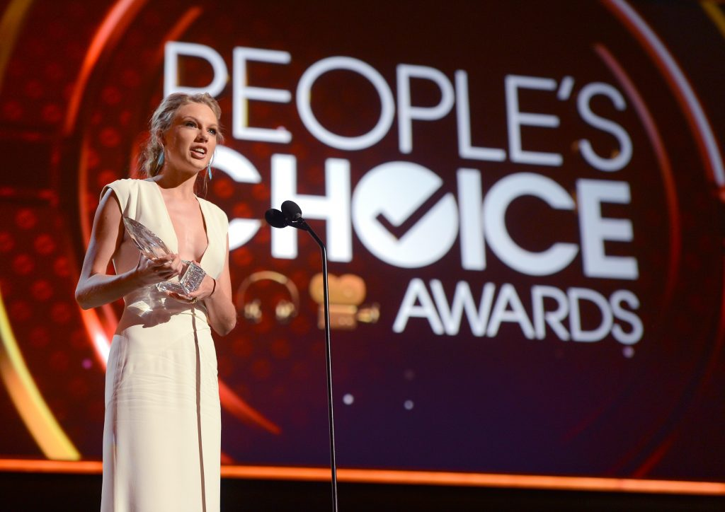 LOS ANGELES, CA - JANUARY 09:  Singer Taylor Swift, winner of Favorite Country Artist Award speaks onstage at the 39th Annual People's Choice Awards at Nokia Theatre L.A. Live on January 9, 2013 in Los Angeles, California.  (Photo by Frazer Harrison/Getty Images for PCA)
