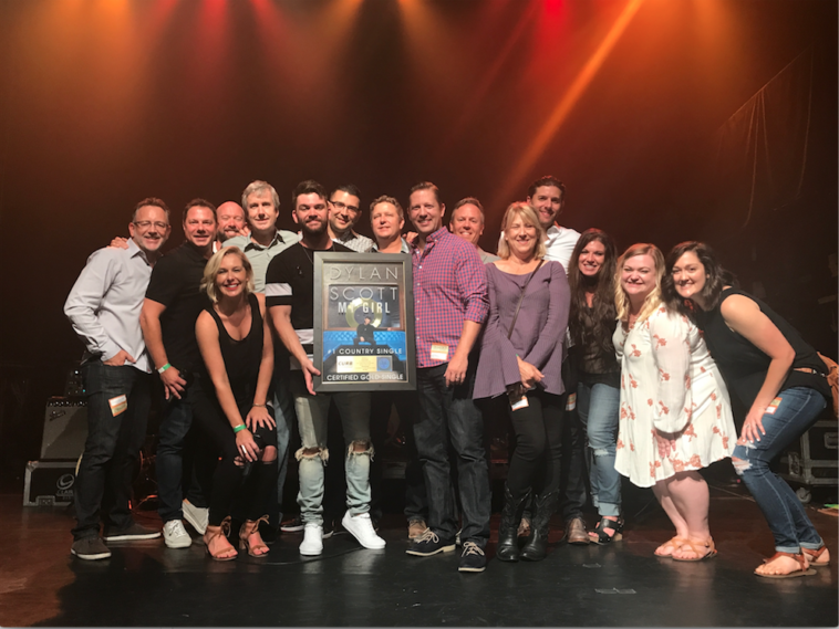 L-R: RJ Meacham (Curb Records); John Fox and Katie Neal (Nash FM 94.7 New York); John Clore and Mike Rogers (Curb Records); Dylan Scott; Mike Allan (Nash FM 94.7 New York); Benson Curb, Ryan Dokke, Jeff Tuerff, Lori Hartigan, Taylor Childress, Brooke Meris, Samantha DePrez and Jessie Lowe (Curb Records)