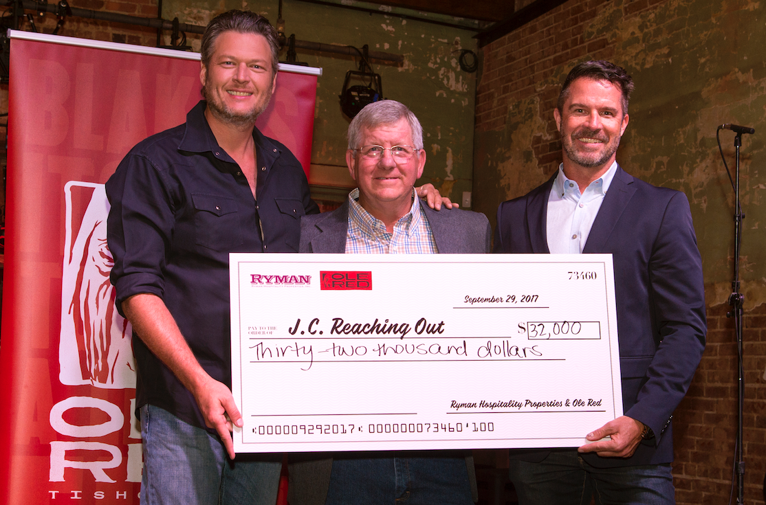 L to R: Blake Shelton, J.C. Reaching Out's Carl Atteberry, and Ryman Hospitality Properties Chief Marketing Officer John Behling