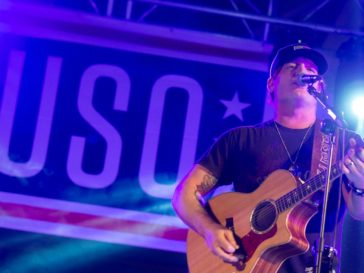 Jerrod Niemann performs for service members at Moron Air Base, Spain, on 2017 Chairman's USO Tour (12/21).
