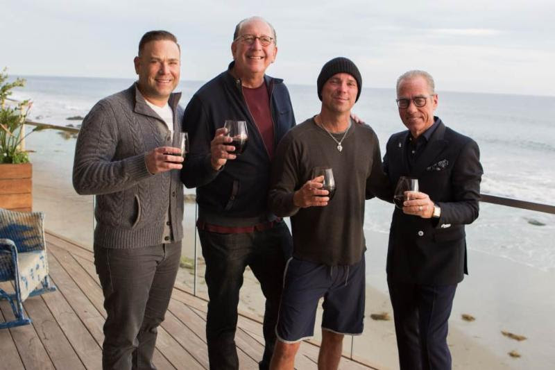 (L to R): Clint Higham (President, Morris Higham Management); John Esposito (Chairman & CEO, Warner Music Nashville); Kenny Chesney; Jess Rosen (Attorney, Greenberg Traurig)