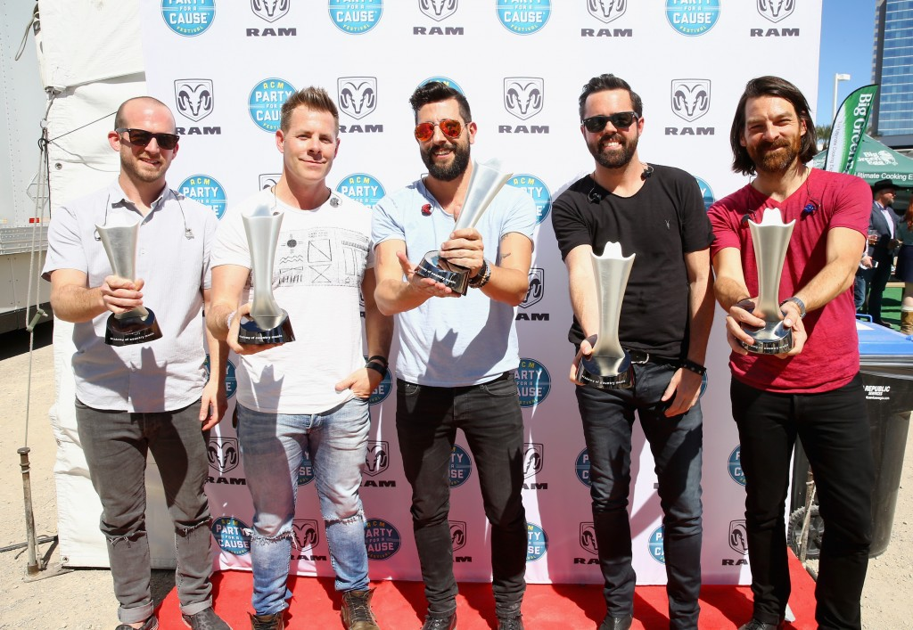 """(L-R) Musicians Whit Sellers, Trevor Rosen, Matthew Ramsey, Geoff Sprung and Brad Tursi of Old Dominion pose with ACM's """"New Artist Award"""" during the 4th ACM Party For A Cause Festival at the Las Vegas Festival Grounds on April 3, 2016 in Las Vegas, Nevada. (Photo by Mark Davis/Getty Images for ACM)"""
