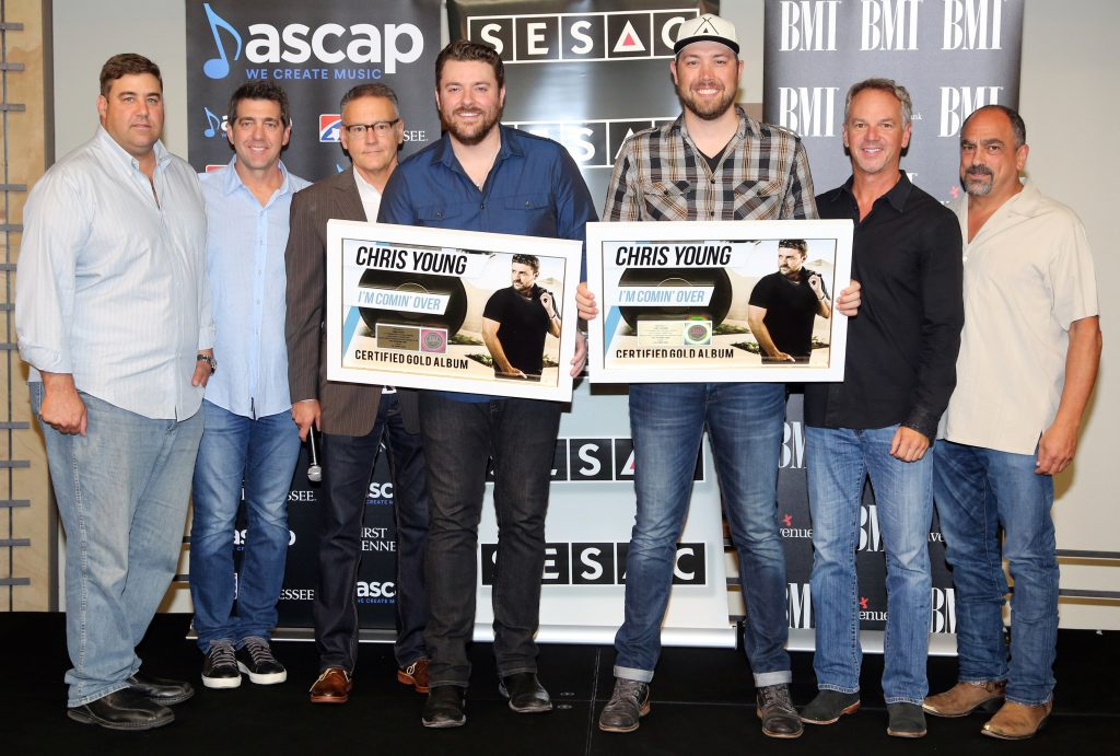 """Chris Young and co-producer Corey Crowder were surprised with the news that the singer's latest album, I'm Comin' Over, featuring back-to-back seventh and eighth No. 1 singles """"I'm Comin' Over"""" and """"Think Of You,"""" has achieved RIAA Gold certification"""